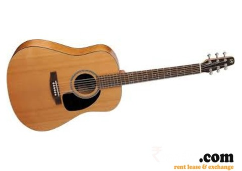 Old acoustic guitar on Rent in Delhi
